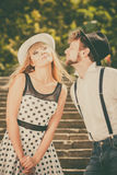 Loving couple retro style flirting on stairs Royalty Free Stock Photography