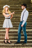 Loving couple retro style flirting on stairs Stock Photography
