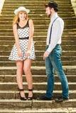 Loving couple retro style flirting on stairs Royalty Free Stock Image