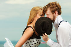 Loving couple retro style kissing on date outdoor Royalty Free Stock Photography