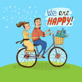 Loving couple riding on a bicycle Stock Image