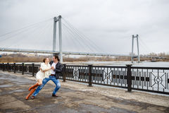 Loving couple on the river bank embraces, kisses Royalty Free Stock Images