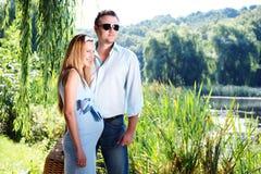 Loving couple on the river shore stock photo
