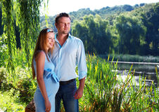 Loving couple on the river shore stock photography
