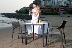 Loving couple at a romantic dinner in the beach Stock Photos