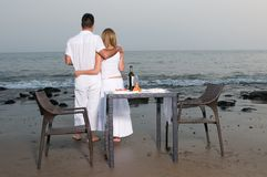 Loving couple at a romantic dinner in the beach Stock Photo