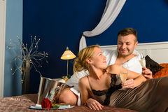 Loving couple romantic Valentine's day lying bed Royalty Free Stock Photos