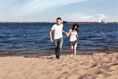Loving couple running on beach Royalty Free Stock Images