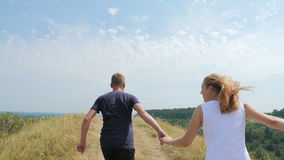 A loving couple runs to the top stock footage