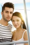 Loving couple on sailboat. Close-up portrait of loving couple on sailing boat smiling Royalty Free Stock Images