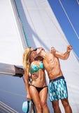 Loving couple on sailboat Stock Photography