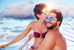 Loving couple on sailboat Stock Image