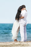 Loving couple on sea background Royalty Free Stock Photo