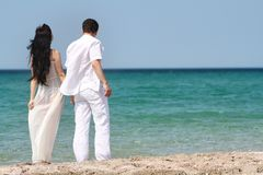 Loving couple on sea background Stock Photos