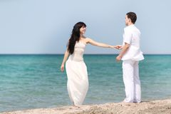 Loving couple on sea background Stock Images