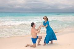 Loving couple on the seashore, Cuba Royalty Free Stock Images