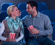 Loving couple sharing their popcorn Royalty Free Stock Images