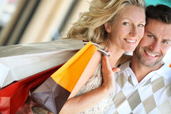 Loving couple shopping. Young attractive happy couple with shopping bags outdoors stock image