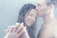 Loving couple in shower. Stock Photography