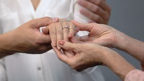 Loving couple showing engagement ring on girlfriends finger to mother, marriage. Stock footage stock footage