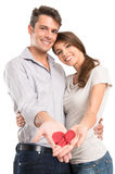 Loving Couple Showing Painted Heart On Hand Stock Image