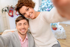 Loving couple sitting in the arm chair Royalty Free Stock Photos