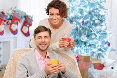 Loving couple sitting in the arm chair Stock Photo