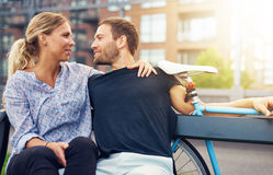 Loving couple sitting on bench Royalty Free Stock Photos