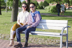 The loving couple is sitting on the bench. Royalty Free Stock Photo