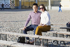 The loving couple is sitting on the bench. Royalty Free Stock Images