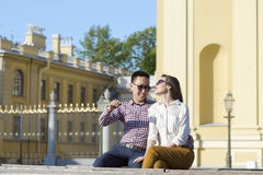 The loving couple is sitting on the bench. stock images