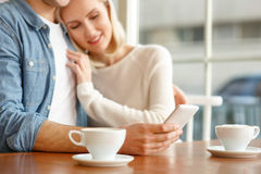 Loving couple sitting in the cafe Stock Photos