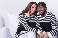 Loving couple sitting on couch Stock Image