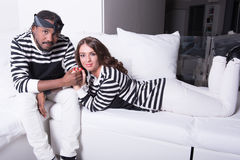 Loving couple sitting on couch Royalty Free Stock Image