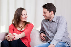 Loving couple sitting on couch Royalty Free Stock Photos