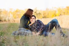 Loving couple sitting on the grass. Royalty Free Stock Photography