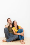 Loving couple sitting on the house floor Royalty Free Stock Photos