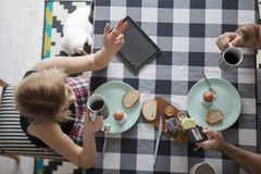 Loving couple sitting at a kitchen table, having a breakfast together Royalty Free Stock Photo