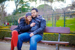 Loving couple sitting on a park bench Royalty Free Stock Image