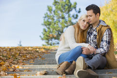Loving couple sitting on park steps Stock Image