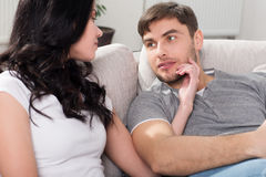 Loving couple sitting on a sofa in the living room Royalty Free Stock Photos