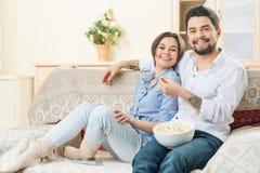 Loving couple sitting on the sofa Stock Photos
