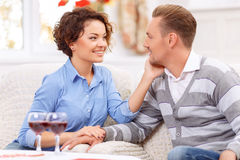 Loving couple sitting at the table Royalty Free Stock Photography
