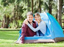 Loving Couple Sitting In Tent At Park Royalty Free Stock Image