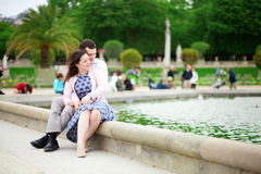 Loving couple sitting by the water Royalty Free Stock Photo