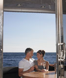 Loving Couple Sitting On Yacht Stock Photography