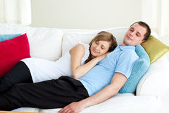 Loving couple sleeping lying on a sofa Royalty Free Stock Photo