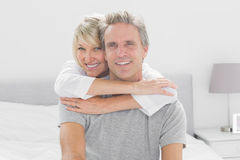 Loving couple smiling at camera Stock Image