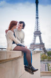 Loving couple smiling near the Eiffel Tower in Paris Stock Photo