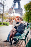 Loving couple smiling near the Eiffel Tower in Paris. Lovers smiling in Paris with the Eiffel Tower in the Background Royalty Free Stock Images